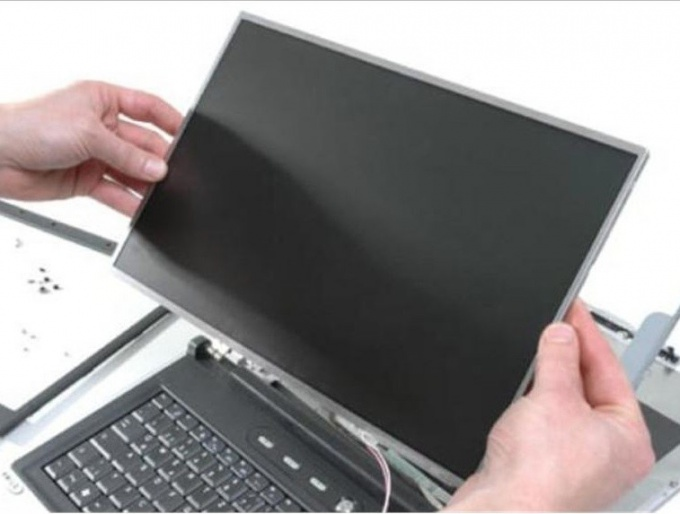 Replacement display for the laptop with their hands