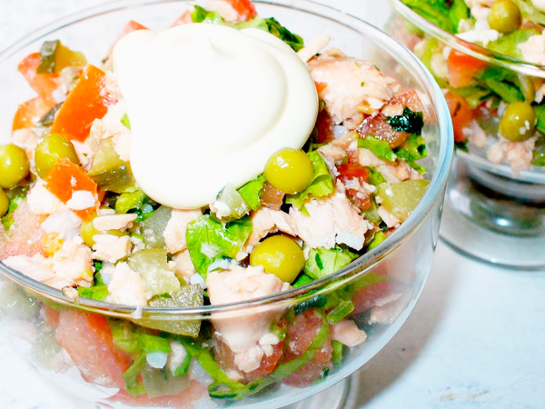 Prepare a salad with boiled salmon