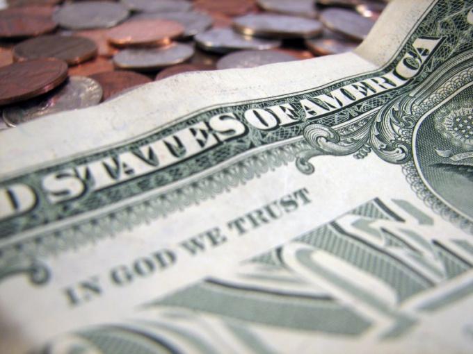 От чего зависит курс доллара