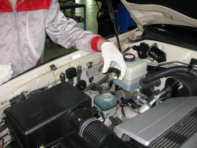 The oil tank is located under the hood of the car