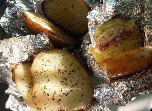 Baked potatoes with bacon in foil