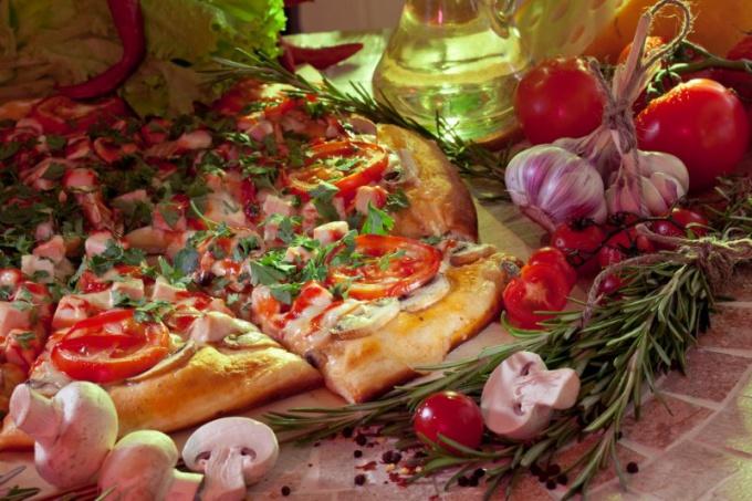 Оливковое масло - неотъемлемая часть настоящей пиццы