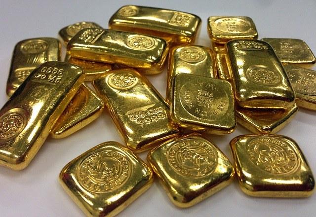 Золотые слитки с указанной пробой