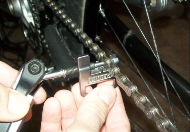 Почему спадает цепь на велосипеде