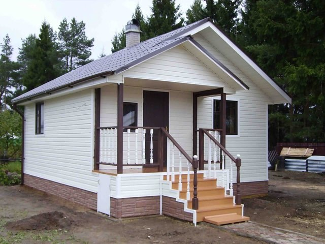 Bath, covered with siding, it looks neat and modern