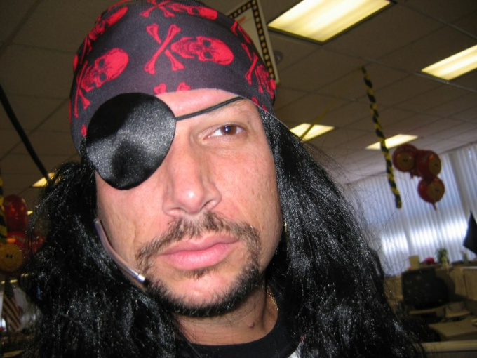 Pirate suit and a black patch on one eye