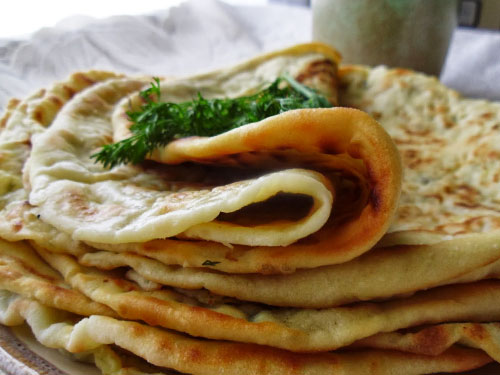 Prepare a khachapuri with spinach and cheese