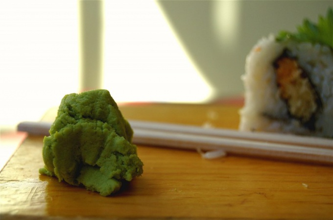 In sushi bars, the rolls and sushi is always served with wasabi
