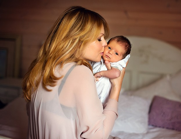 Младенцы на руках - почти всегда благоприятный сон