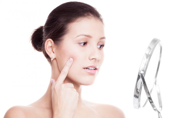 Removal of inflammation from acne