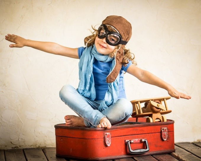 Until what age should the child need permission to travel abroad