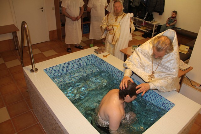 Do you need godparents at the baptism of an adult