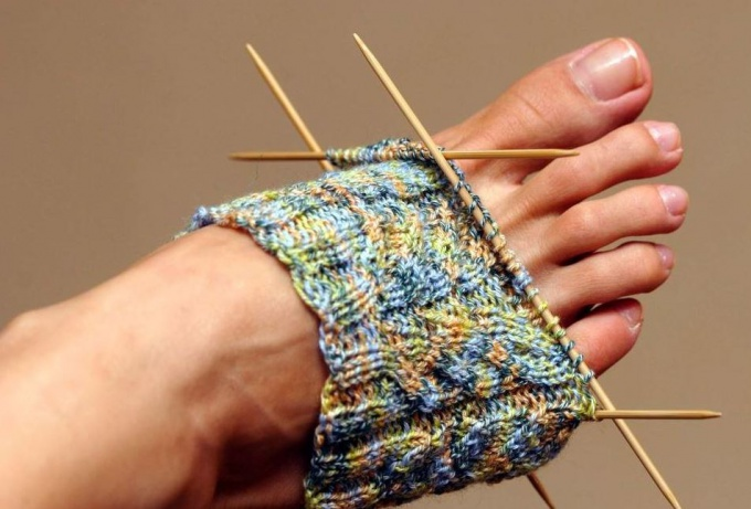 How to knit socks with needles, source freerangestock.com
