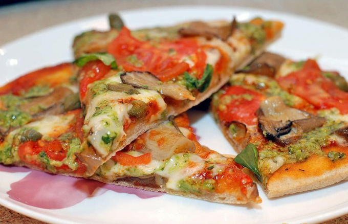 Pizza with mushrooms and sausage