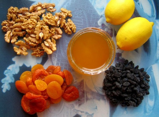 A mixture of dried apricots, raisins, honey, prunes and walnuts