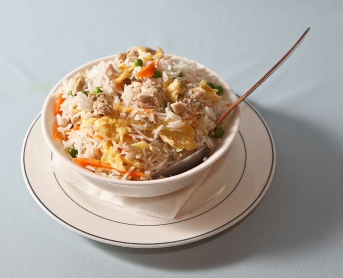 Rice with meat and vegetables in pots under a fur coat dough