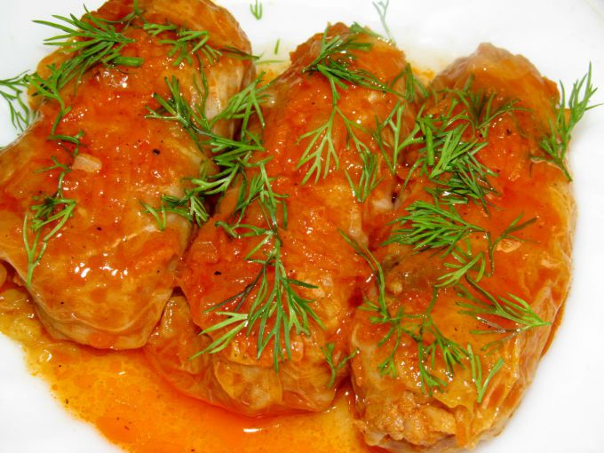 Cabbage rolls with millet and cheese in a slow cooker