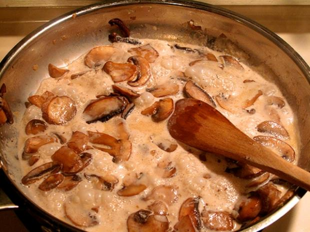 Juicy mushrooms in a milk fill