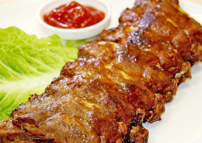 Baked beef ribs in mustard and honey sauce