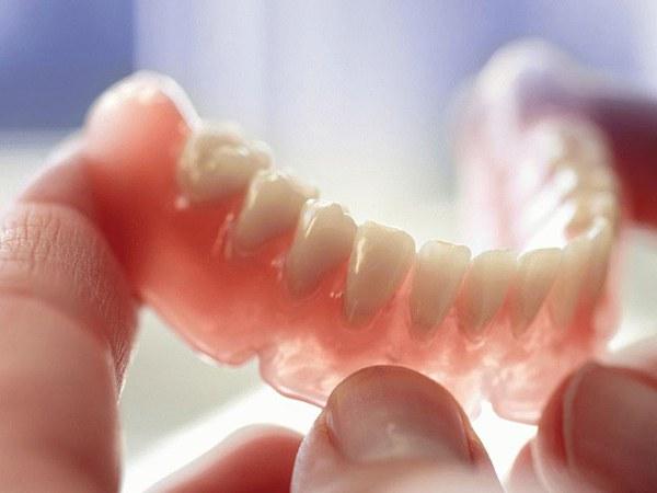 Что такое покрывной зубной протез